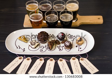 Tasting of beer and pattie chocolate pastries. - stock photo