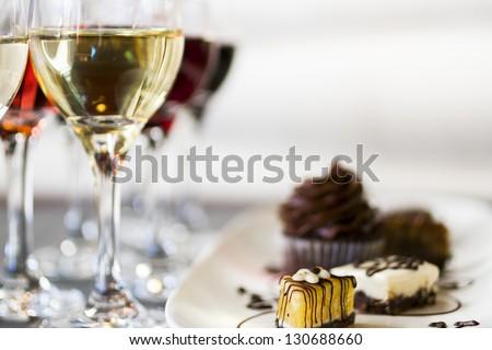 Tasting of wine and pattie chocolate pastries. - stock photo