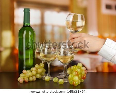 Tasting white wine on room background - stock photo