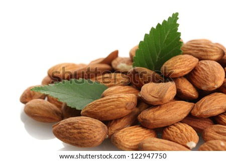 tasty almonds nuts with leaves, isolated on white - stock photo