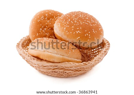 tasty and appetizing buns in basket on white background - stock photo