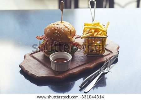 Tasty and appetizing hamburger  and french fried. - stock photo