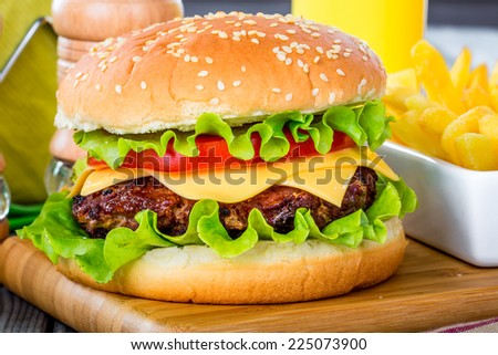 Tasty and appetizing hamburger cheeseburger - stock photo