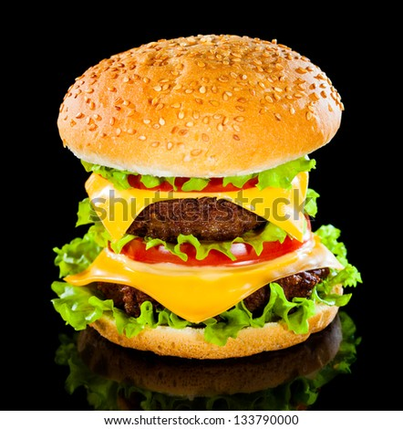 Tasty and appetizing hamburger on a darkly background - stock photo