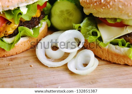 Tasty and appetizing hamburger on wooden  plate