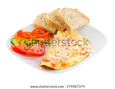 Tasty and delicious cheese omlette with vegetables, cheese and whole wheat bread. - stock photo
