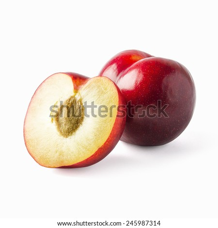 Tasty and glossy plums with sliced one isolated on white - stock photo