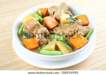 Tasty and healthy curry souse with  chicken and vegetables. - stock photo