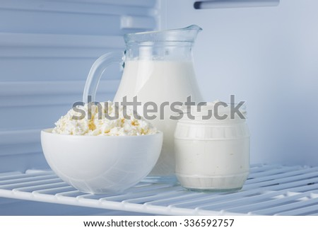 tasty and healthy dairy products in the refrigerator: sour cream, cottage cheese and milk