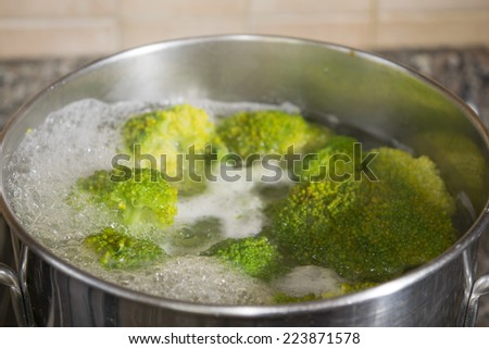 tasty and healthy vegetarian meals: broccoli in pot - stock photo