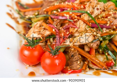 Tasty appetizer of roast beef meat, marinated chicken meat, cherry tomato and other vegetables