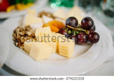 Tasty appetizer.  Plate of Cheese on white plate at a restaurant - stock photo