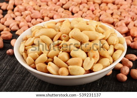Tasty appetizer Roasted peanuts served with raw nuts,