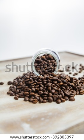 tasty aromatic coffee beans in a glass cup