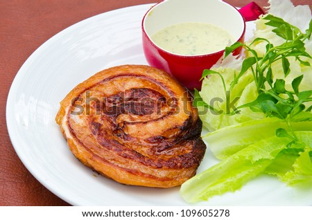 Tasty bacon grilled with vegetables - stock photo