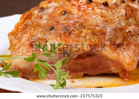 Tasty baked meat on a white plate