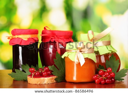 tasty berry and fruit jam and berry on a green background Listen berry and fruit jam and fruit Listen tasty berry and fruit jam and berry