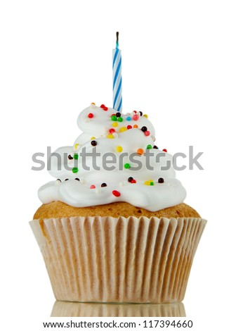 tasty birthday cupcake with candle, on grey background - stock photo