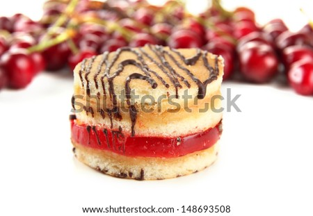 Tasty biscuit cake and berries isolated on white
