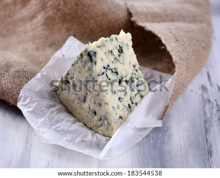 Tasty blue cheese, on wooden table