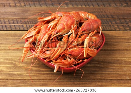Tasty boiled fresh crayfishes on a red bowl - stock photo