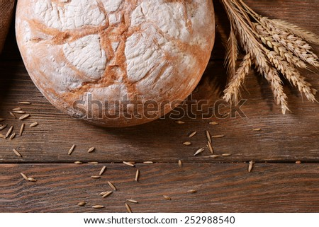 Tasty bread on table close-up - stock photo
