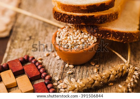Tasty bread with sesame seeds - stock photo