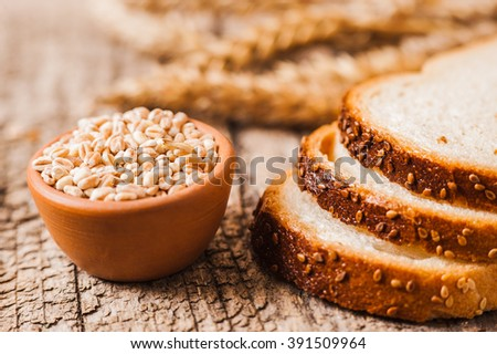 Tasty bread with sesame seeds. fresh wheat grains and flour.Slices of bread - stock photo