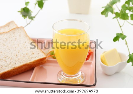 Tasty breads with a glass of juice