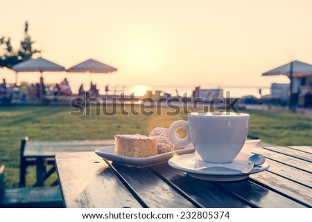 Tasty breakfast with cup of coffee and fresh biscuits - stock photo