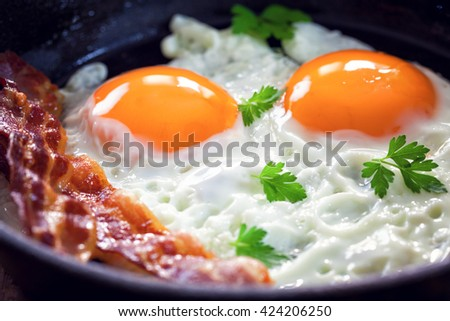 Tasty breakfast with fried eggs and bacon - stock photo