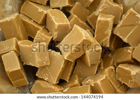 Tasty brown caramerl fudge served on a plate - stock photo