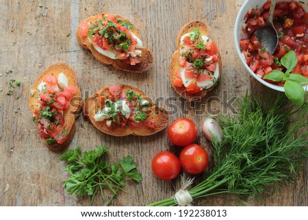 Tasty bruschettas with fresh tomato, garlic, fennel and mozzarella