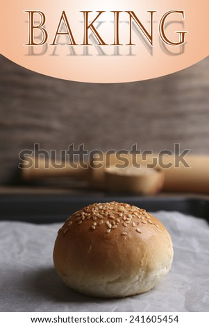 Tasty bun with sesame on oven-tray, Baking concept - stock photo