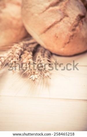 Tasty buns on wooden background - stock photo
