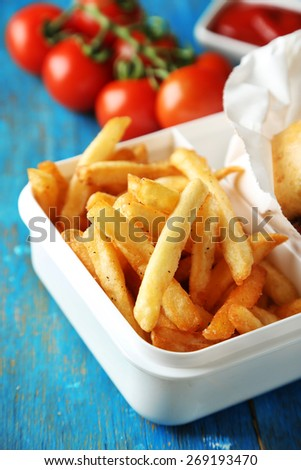 Tasty burger and french fries on wooden table background  Unhealthy food concept - stock photo