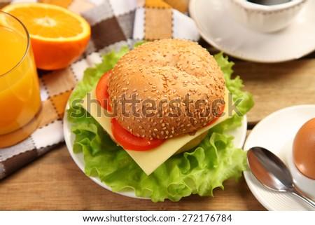 tasty burger on wooden table - stock photo