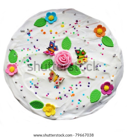 Tasty cake decorated with flower and butterfly - stock photo