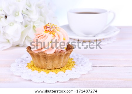 Tasty cake on table on light background
