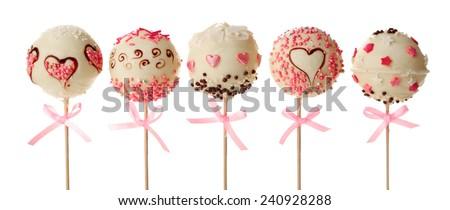 Tasty cake pops, isolated on white - stock photo