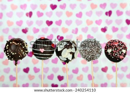 Tasty cake pops on color background - stock photo