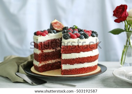 Tasty cake with berries on table
