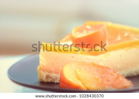 Tasty cake with fresh orange fruits