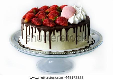 tasty cake with fresh strawberries and chocolate drip - stock photo
