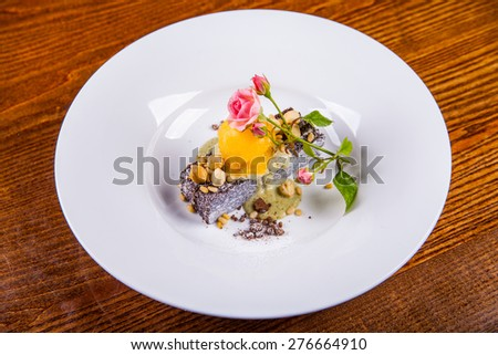 Tasty cake with nuts and ice cream - stock photo