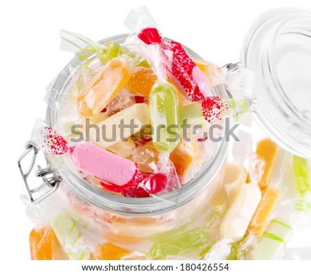 Tasty candies in jar isolated on white - stock photo