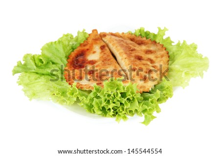 Tasty chebureks with fresh herbs on plate, close-up