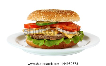 Tasty cheeseburger on plate, isolated on white - stock photo