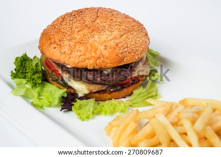 Tasty cheeseburger with fried potatoes, isolated on white.