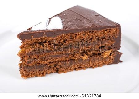 Tasty chocolate cake on a plate closeup - stock photo